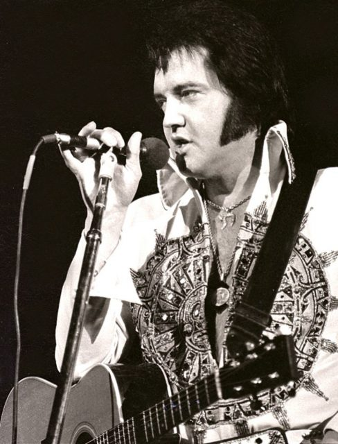 MILWAUKEE, WI – APRIL 1977: Elvis Presley performs in concert at the Milwaukee Arena on April 27, l977 in Milwaukee, Wisconsin. (Photo by Ronald C. Modra/ Getty Images)