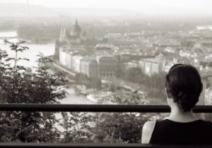 woman looking out over budapest
