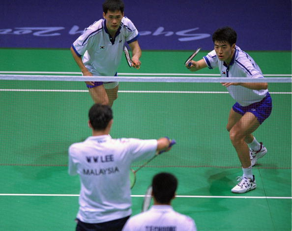 20 Sep 2000: Tan Fook Choong and Wan Wah Lee of Malaysia take on Dong-Soo Lee and Yong-Sung Yoo of Korea in the Mens Doubles Badminton Semifinal at the Sydney Showground on Day Five of the Sydney 2000 Olympic Games in Sydney, Australia. Mandatory Credit: Robert Cianflone /Allsport