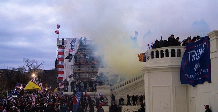 Tear gas outside the United States Capitol on 6 January 2021 (Photo by: Tyler Merbler   Wikimedia Commons)