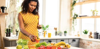 Black woman preparing a healthy meal. (Photo by: Yacobchuk | iStock via Getty Images Plus)