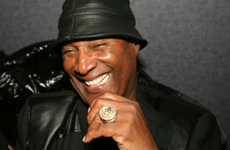 Paul Mooney at a promotional event for Charlie Murphy to promote his book The Making of a Stand Up Guy in December 2009. (Photo by: Timothy M. Moore   wikicommons)