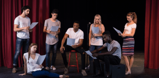 Actors reading their scripts on stage (Photo by: Wavebreakmedia | Envato Elements)