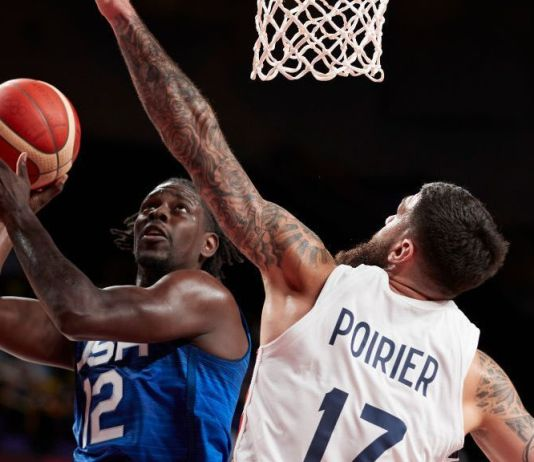 Jrue Holiday of USA and Vincent Poirier of France battle for the ball on day two in the Men's First Round Group A match between France and USA at the Tokyo 2020 Olympic Games at Saitama Super Arena on July 25, 2021 in Saitama, Japan. (Photo by Berengui/DeFodi Images via Getty Images)