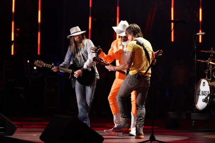 "Lil Nas X, Billy Ray Cyrus and Keith Urban surprise CMA Fest attendees with an epic performance of ""Old Town Road"" at Nissan Stadium in Nashville Saturday, June 8. (Photo Credit: Donn Jones/CMA)"