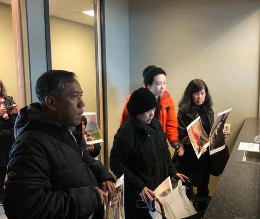 Thant, Yin Yin, and Hla Myaing waiting in the IIO office. Only after we started chanting did somebody come out to receive the Dins' petition. (Ivan Drury / The Volcano)