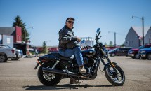 """Mayor of Ryder, Jody Reinisch, presides over the town's Main Street. To launch riding season, Harley-Davidson will ride into Ryder Saturday, June 3 with the aim of creating the first fully motorcycle licensed town. Ryder city officials will change the town's name to """"Riders"""" this riding season to commemorate the experience."""