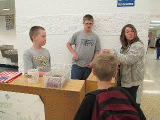 Austin Agler and Zach Dillon sell school supplies to students at the Lancer Supply stand that operates each morning as part of the sixth grade Math project. (Photo submitted.)
