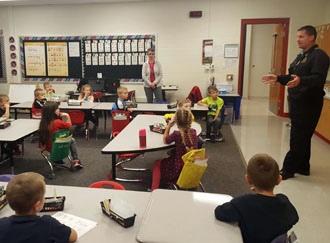 Van Wert Fire Department Captain Craig King, who is also Middle Point fire chief, is shown discussing the importance of having a functioning smoke detector to students in Amy Smith's kindergarten class at the Van Wert Early Childhood Center. (photo submitted)
