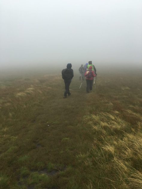 Bracing ourselves against the wind and mist.