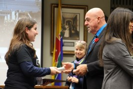 Mayor Keith Hobbs, right, awards a medallion to a representative of Zone Watch during Monday night's Mayor's Community Safety Awards Ceremony. Zone Watch was recognized as an Outstanding Community Project.
