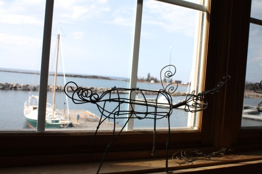 A moose made of wire watches us work in a North House classroom overlooking Lake Superior.