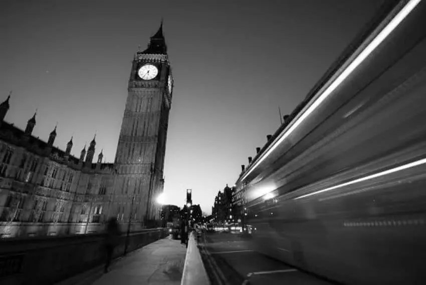 Big Ben and a London Bus photographed on Westminster Bridge.
