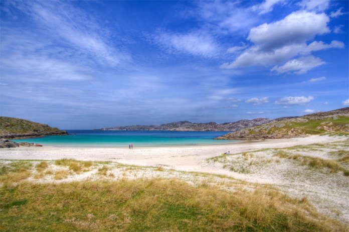 Achmelvich Beach is a stunning beach with white sand and a popular spot for water skiers, windsurfers and kayakers. It is a busy beach during the summer months.