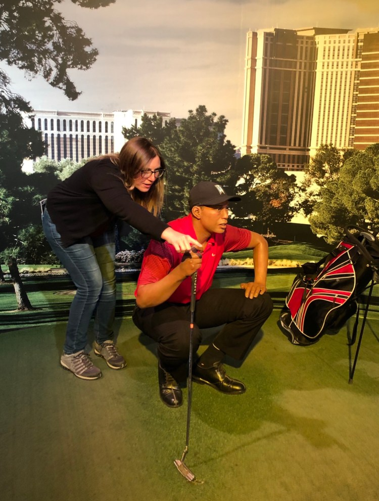 Girl with wax figure of Tiger Woods