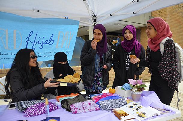 Members of MSA hold World Hijab Day.