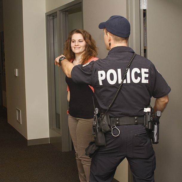 A police officer directs HSEWI's Director of Operations Chelsie Hanks.