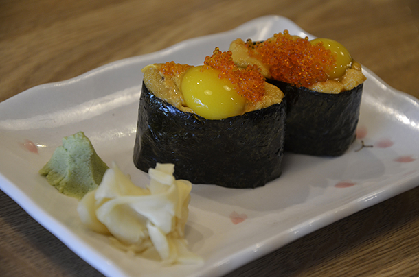 Uni roll with a quail egg and salmon roe.
