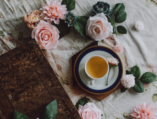 Roses with cup of tea