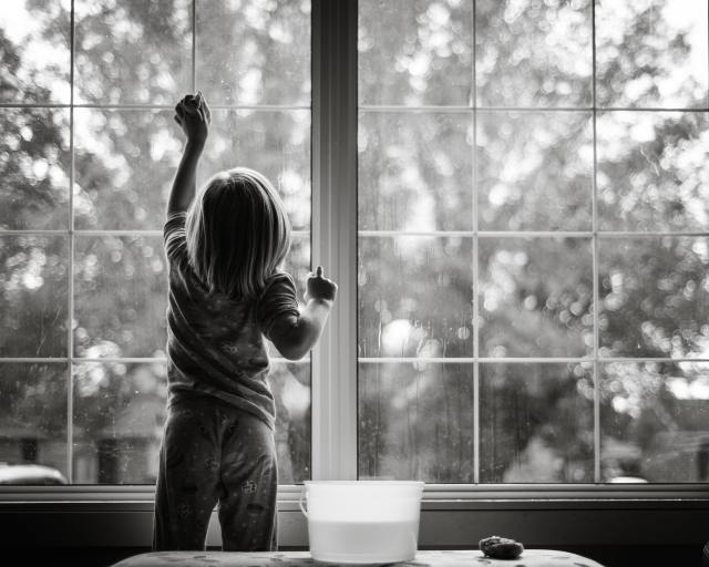 Girl cleaning windows