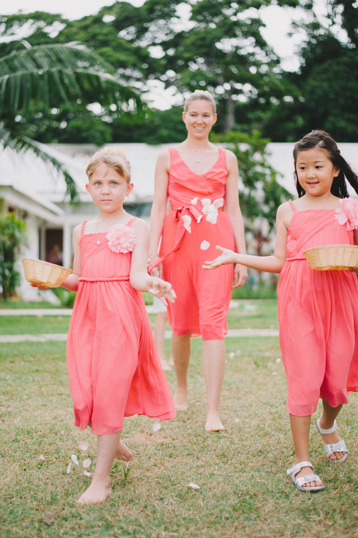 Flowergirls in coral. Photo by Andri Tei Photography. www.theweddingnotebook.com