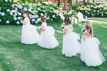 Lovely flowergirls dresses by Donna Tobin Couture. Photo Ben Yew Photography. www.theweddingnotebook.com