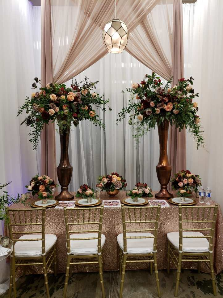 Spring Sarnia Wedding Expo gorgeous head table in gold and bronze by Julia Weddings