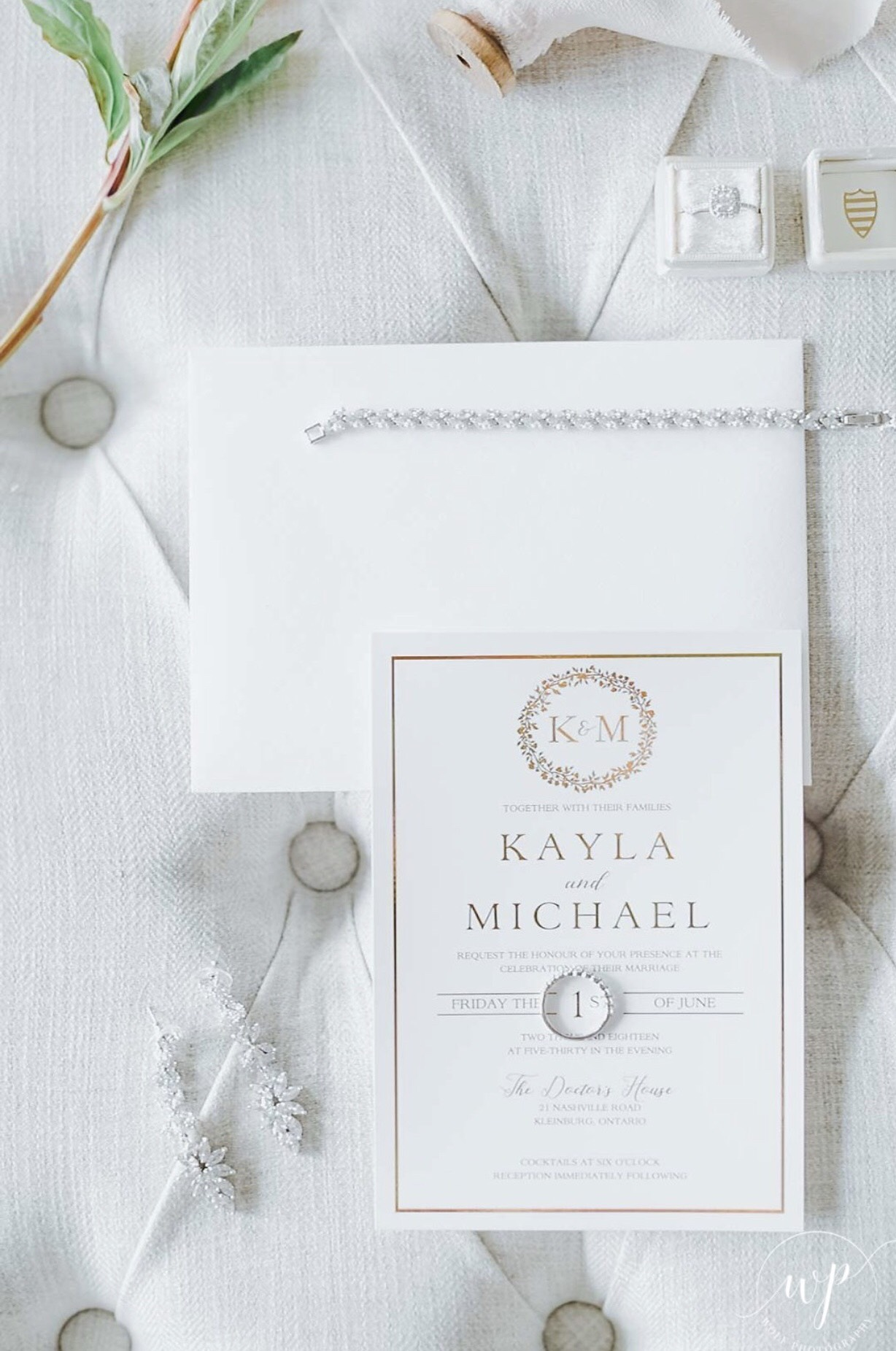 Gold foil wedding invitation flat lay on wedding day