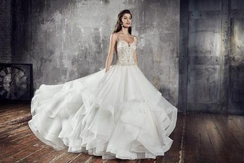 creme couture wedding gown with ruffled bottom