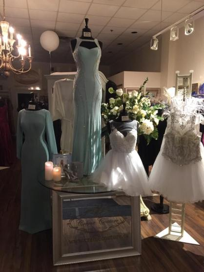 creme couture display of flowergirl and bridesmaid dresses