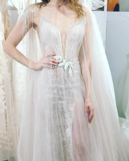creme couture bride with hand on her hip wedding gown