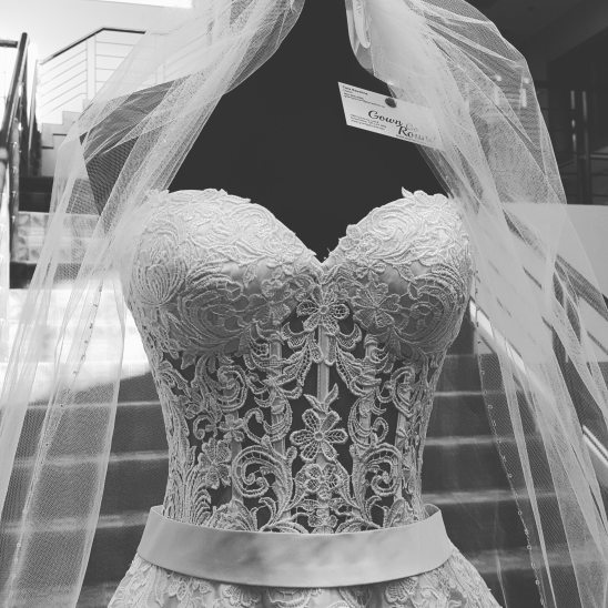 wedding dress and veil on mannequin