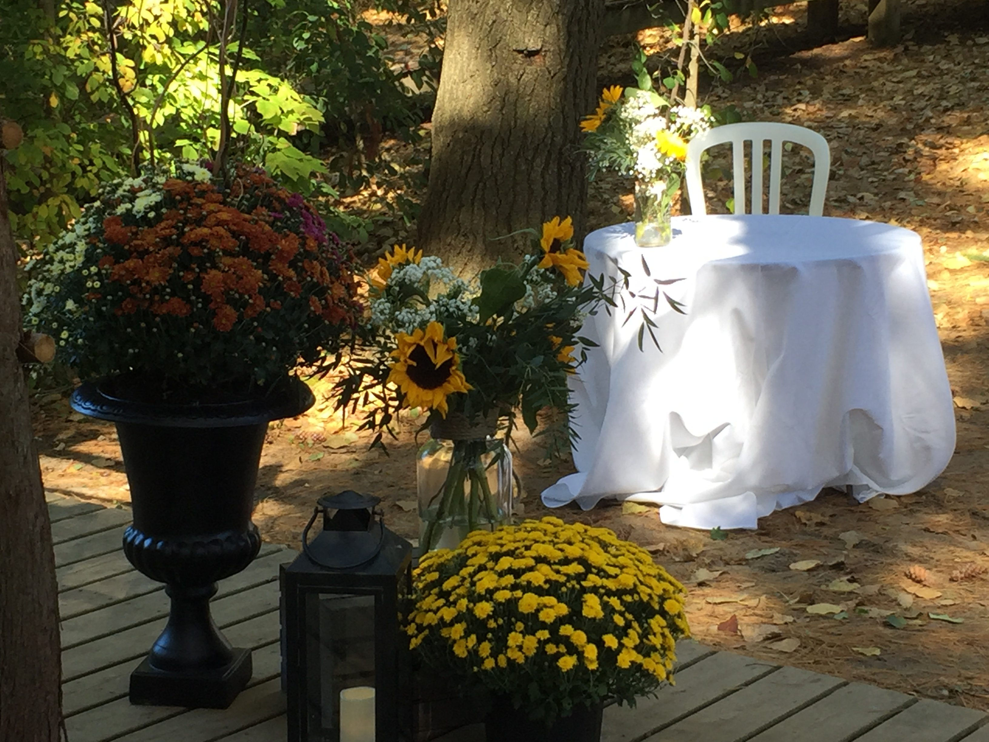 Now & Always fall mums and greenery wedding decor