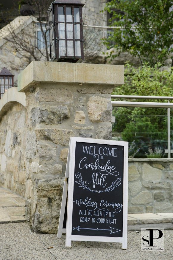 Cambridge couple designs rustic wedding with white and green