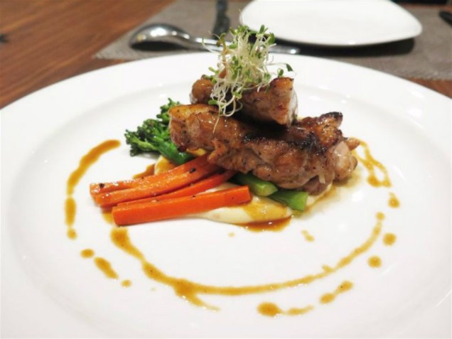 Grilled Chicken Thigh served with garlic mashed potatoes, garlic buttered broccolini & signature foie gras sauce