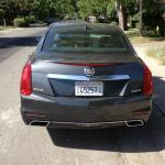 The rear end of the 2014 Cadillac CTS has sharp, pointed lines.