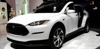 Tesla has unveiled its $130,000 Model X SUV.