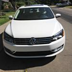 The 2014 Volkswagen Passat has a sharped angled hood and front lights perspective.