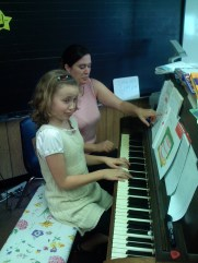 An excellent piano student --or class clown?