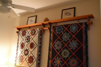 Judy's Quilts on racks