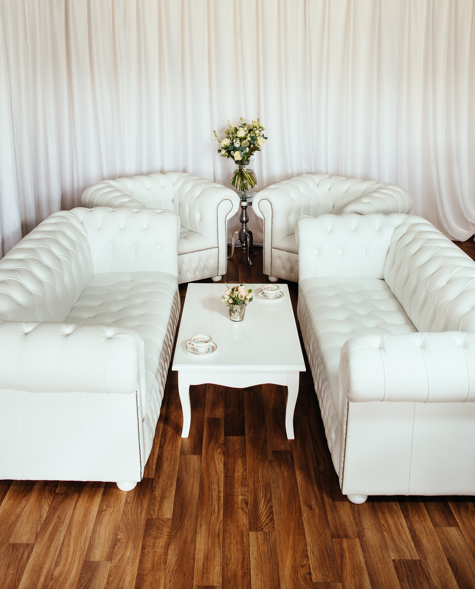 wedding chair cover hire chesterfield cosco baby luxury british made white leather sofa set