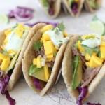 Pork Tacos with Mango Salsa + Cilantro Lime Crema