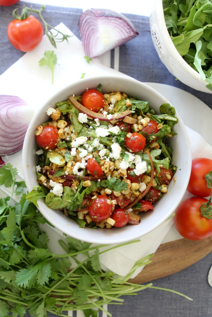 An easy to make summer salad with tomatoes and corn from the Whole Smiths. SUCH a hit and a total crowd pleaser. A must-make.