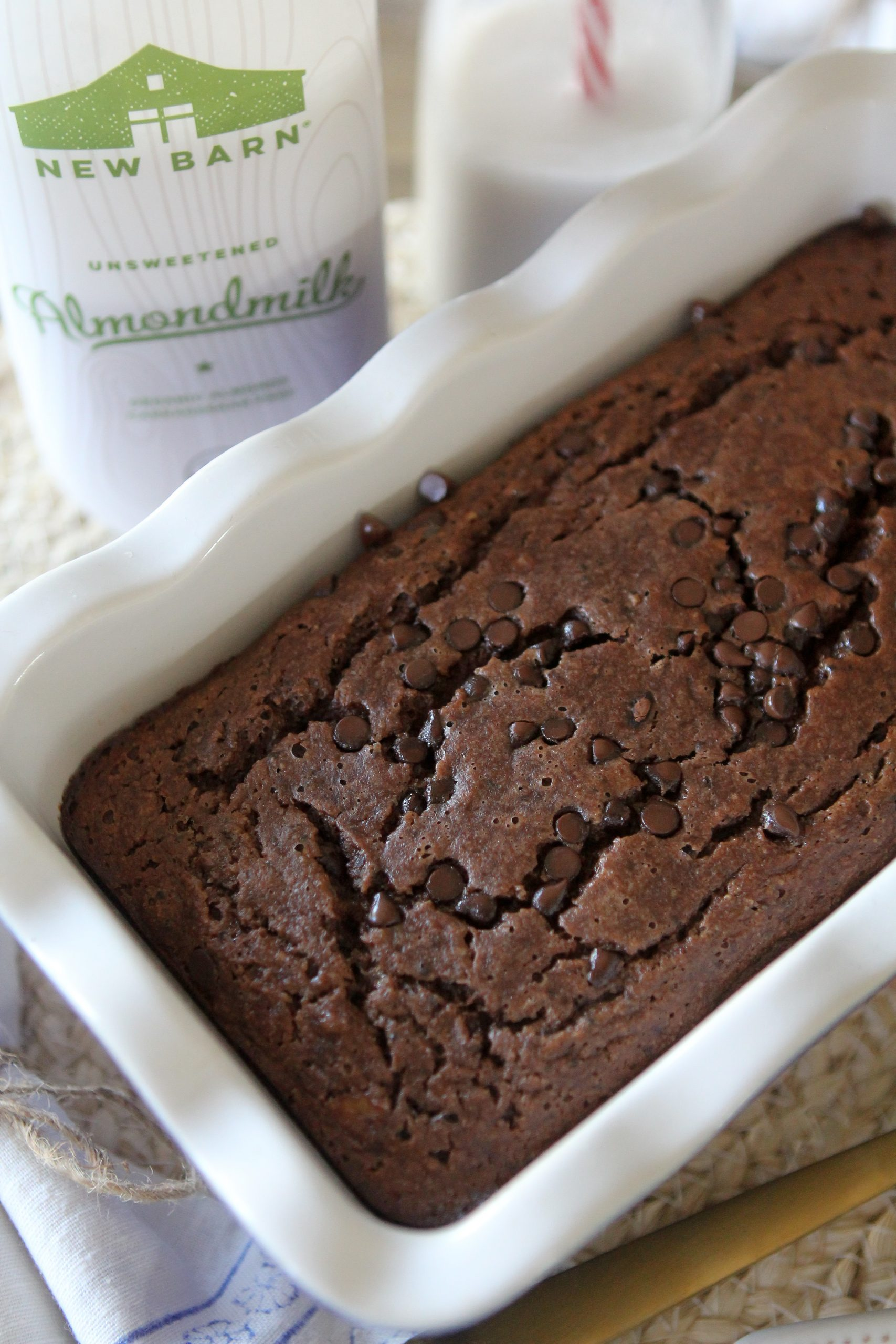 A grain-free Paleo Chocolate Banana Bread from the Whole Smiths brought to you by New Barn Organic Almondmilk. This recipe is sure to become a family favorite around the house! Gluten-Free.