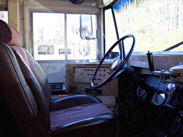 bus tiny home driver's seat conversion
