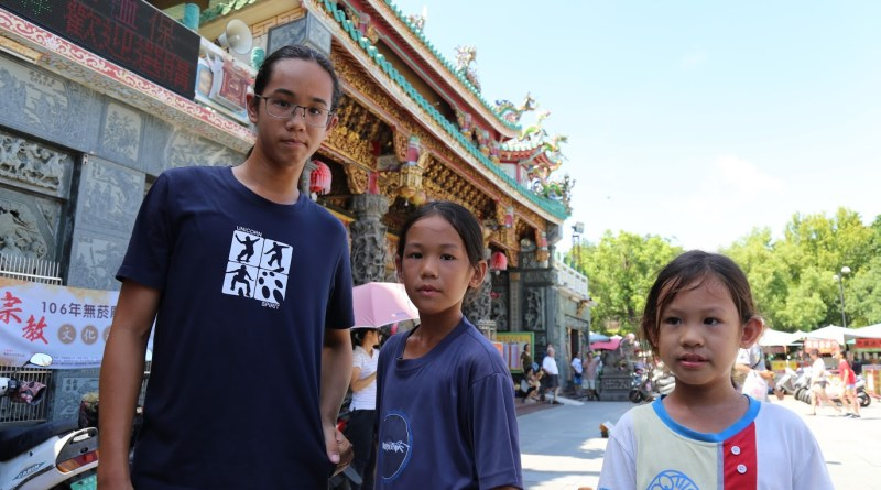 The Coolidge Brothers outside a temple in Tainan City, Taiwan