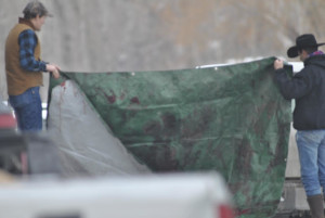 Derby participants attempt to obscure line of sight with tarp. Photo: wildlandsdefense.org