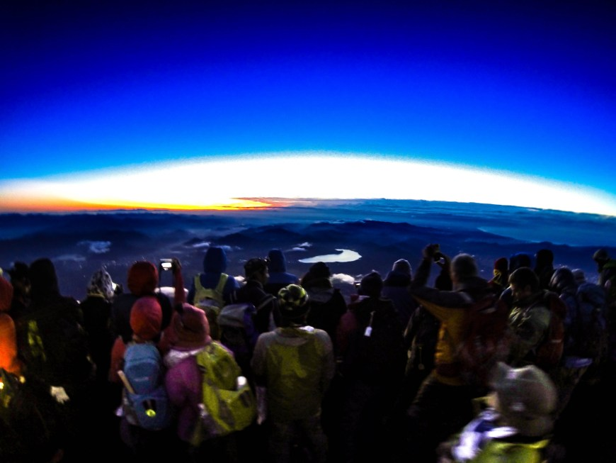 I climbed Mt. Fuji, but when I reached the summit there were a million people. Mt. Fuji is extremely popular, so everyone was crowded around to watch the sunset. Mt Fuji climbing can be exhausting, but we were all excited for the sunrise