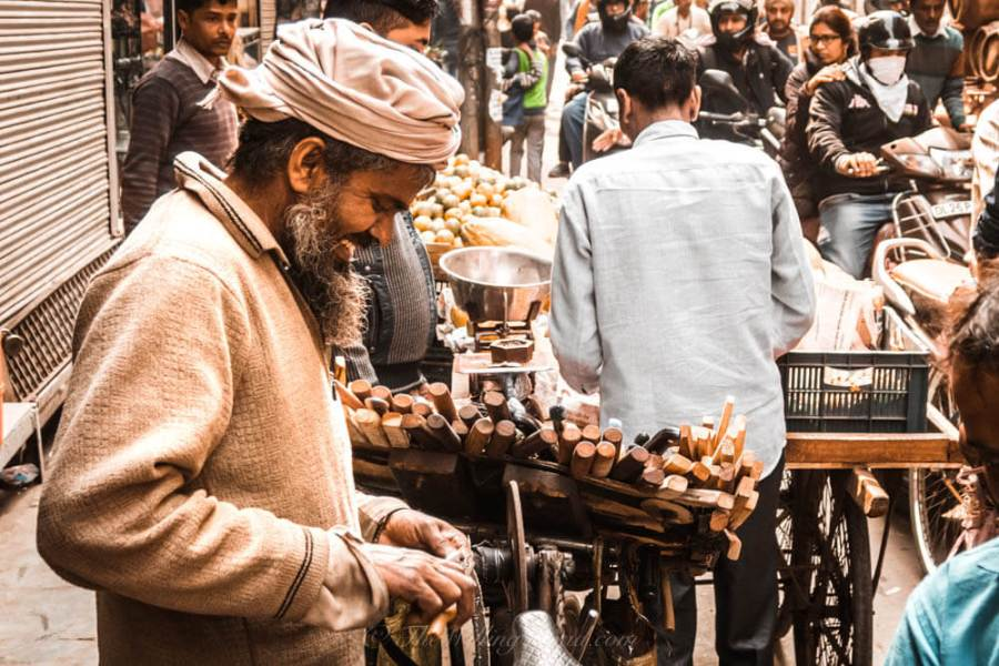 Chadni Chowk: A man is laughing at something while fixing an item