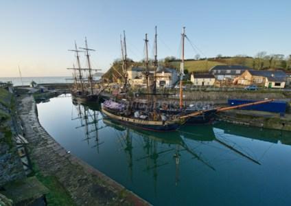 Three tall ships in Charlestown, Cornwall